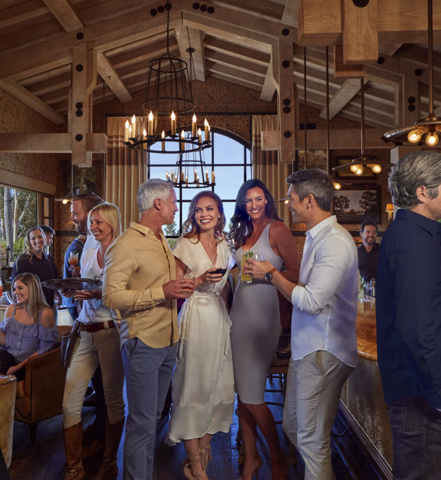 Two men and two women with drinks at the Pony Bar at Rancho Valencia Resort near Del Mar, CA