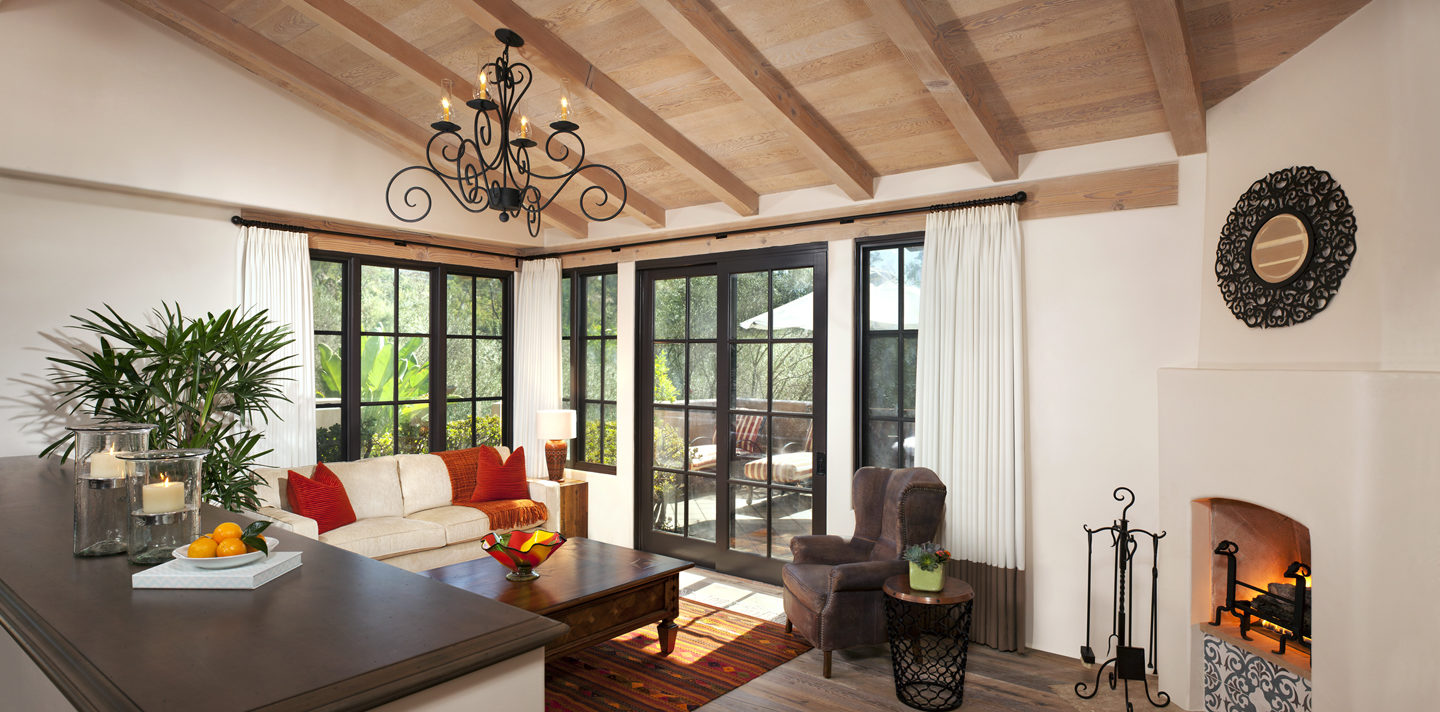 Eucalyptus Double Queen bedroom suite sitting area with couch, french doors to private patio, fireplace at Rancho Valencia