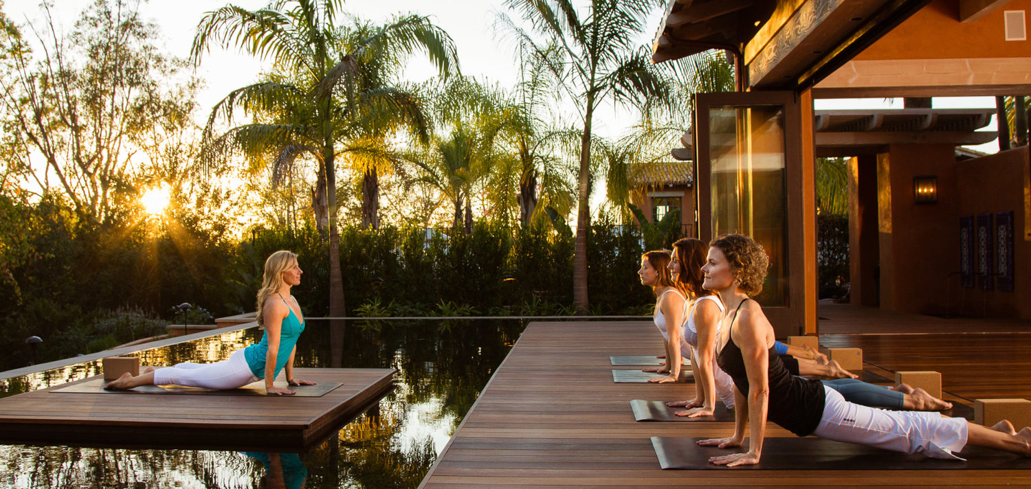 Yoga instructor leading class at yoga pavilion at Rancho Valencia Resort & Spa in San Diego