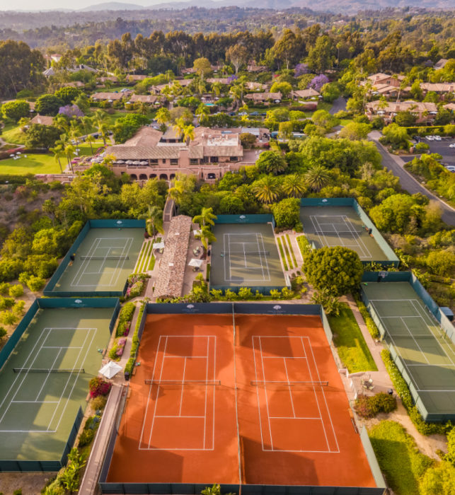 Red clay and hard court tennis courts at Rancho Valencia tennis resort in California