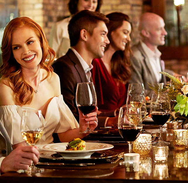 Friends dining and drinking wine at 5 star resort in San Diego, Rancho Valencia Resort
