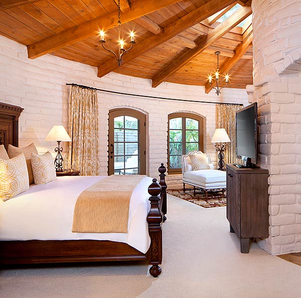 King bedroom with door to patio, TV and sitting area at luxury hotel in Southern California, Rancho Valencia