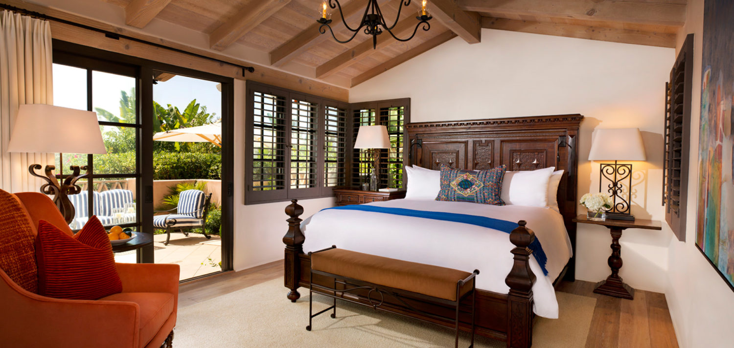 King bedroom with door to private patio at Rancho Valencia 5 star luxury resort in San Diego