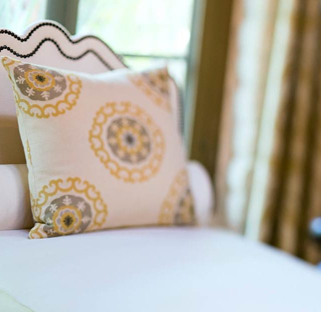 Decorative pillow on bed at Rancho Valencia Resort & Spa in San Diego