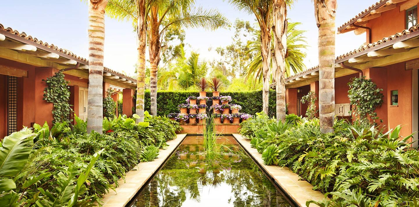 Fountain surrounded by garden foliage and flowers at Rancho Valencia spa resort in Southern California