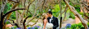 Married couple kissing at San Diego wedding reception venue